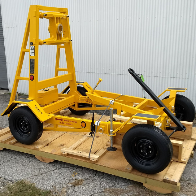 """Part Number: 200-000-101 NSN: 1740-00-106-8512  DESCRIPTION  Four wheeled trailer with brakes, leveling jacks, tie down rings, pintle hook, tow bar, and tool box. This is part number is equal to LMC 404190-3.  FUNCTION  The unit is used for transportation, storage, and maintenance of the Rolls Royce AE2100D3 (without propeller) and the Allison T56-D22, A-9D, 7A, -15, -425 (with adapter),-427 (with adapter). The unit is also used as a work platform when working on the engine off the aircraft.  DIMENSIONS AND WEIGHT  130"""" (L) X 79"""" (W) X 94"""" (H) 1442 lbs."""