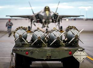 MHU-110_GBU-31 Bombs and F35 in Backgrnd