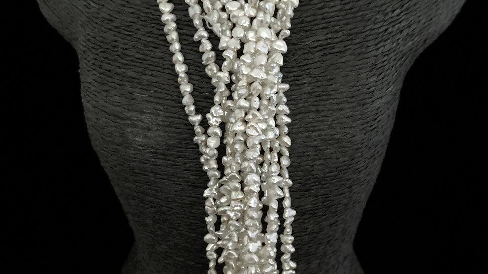 Japanese Akoya Saltwater Keshi Pearls Item N-84-12MA