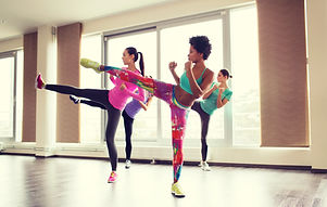 fitness, sport, training, gym and martial arts concept - group of women working out and fighting in