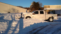 Pickup plow truck removing snow