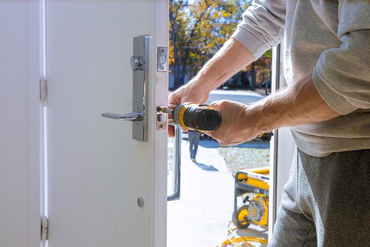 builder-in-installing-a-door-lock-the-do