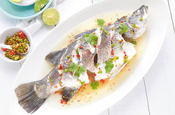 Steamed Barramundi fish with Lime and Garlic Dressing