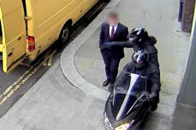 Image of mugging on moped