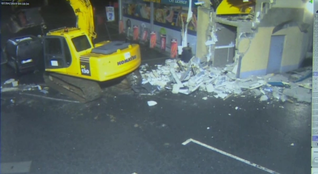CCTV shows digger ripping out cash machine!