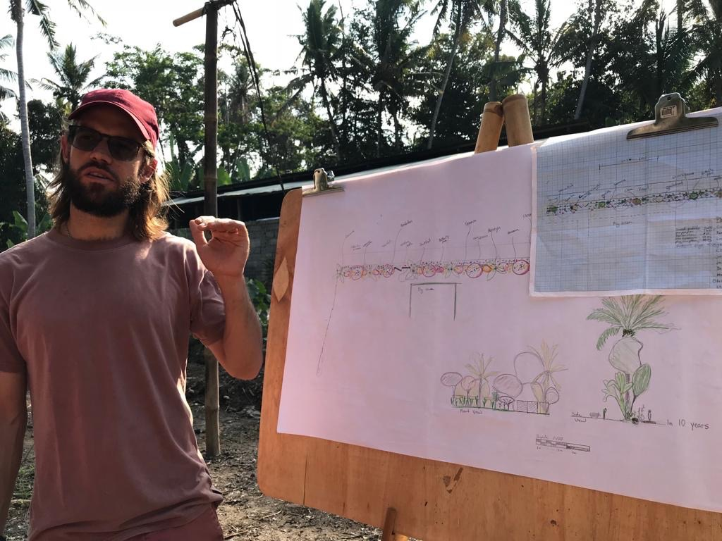 Orin Hardy explaining his plan to plant a fedge (fruis hedge) to block the noise and smell of the pigs next door.