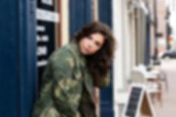 high school senior girl posing in an urban location