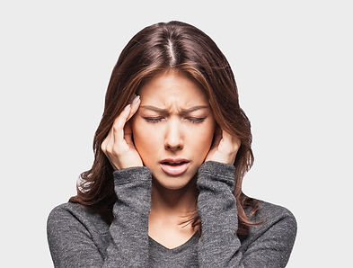 Young woman has headache, isolated on gr