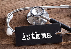 Stethoscope on wood with Asthma word as