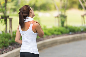 Neck pain during training. Athlete runni
