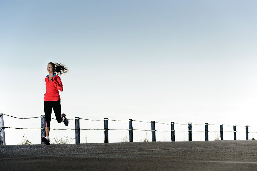 Running fitness training woman outdoors.