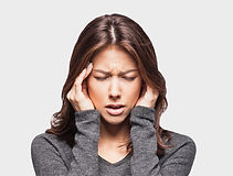 Young woman has headache isolated on gra