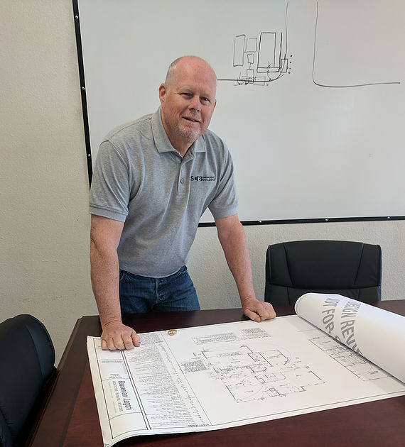 Bill Keith, Sonoma County Builders Construction Manager reviews plans