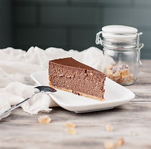 A slice of a chocolate cheese cake on a