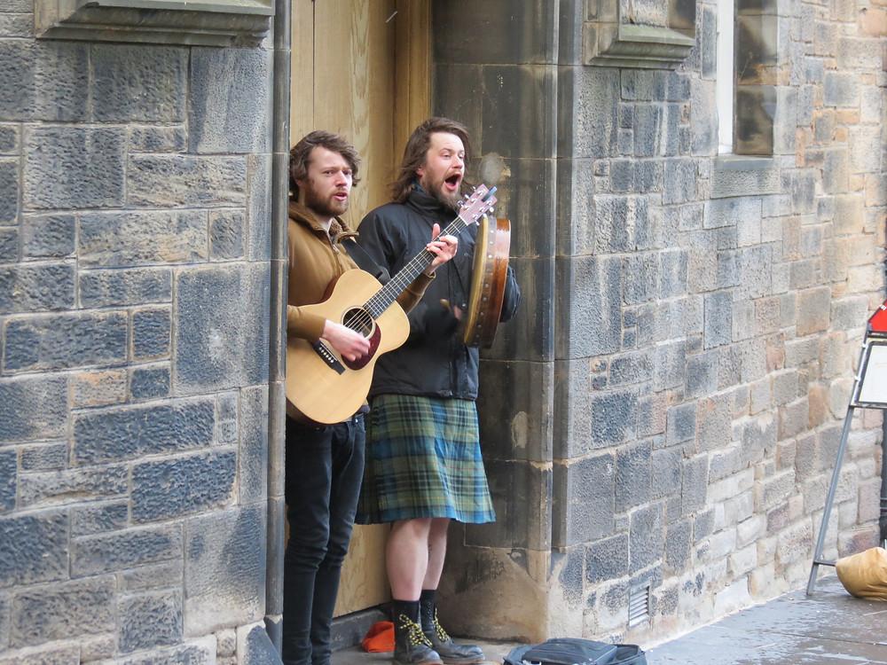 Entertainers outside pub