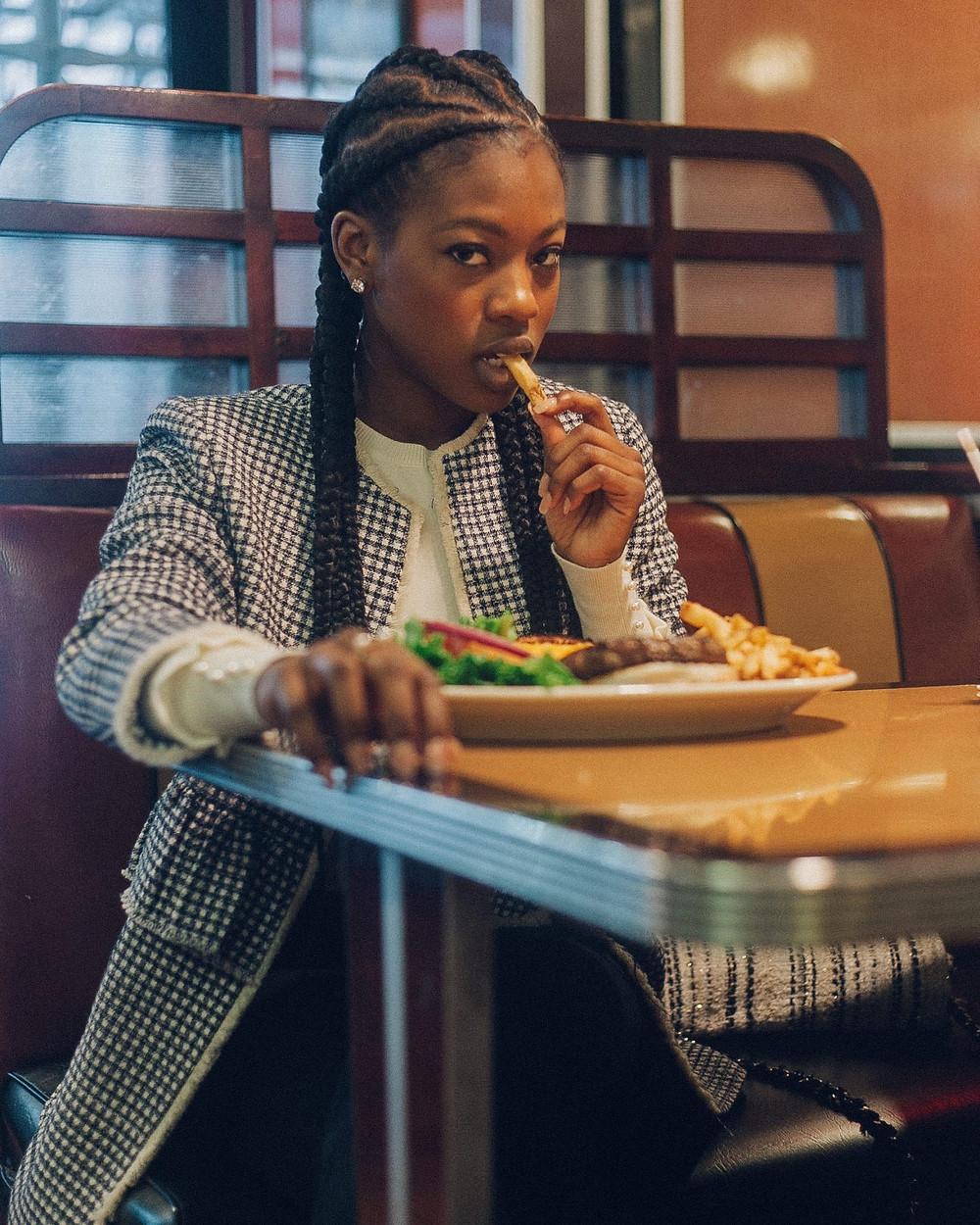 Black girl eating french fries