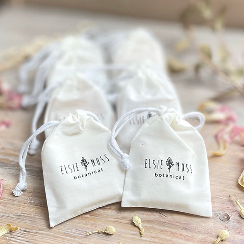 10 individual guest soaps in cotton drawstring bags