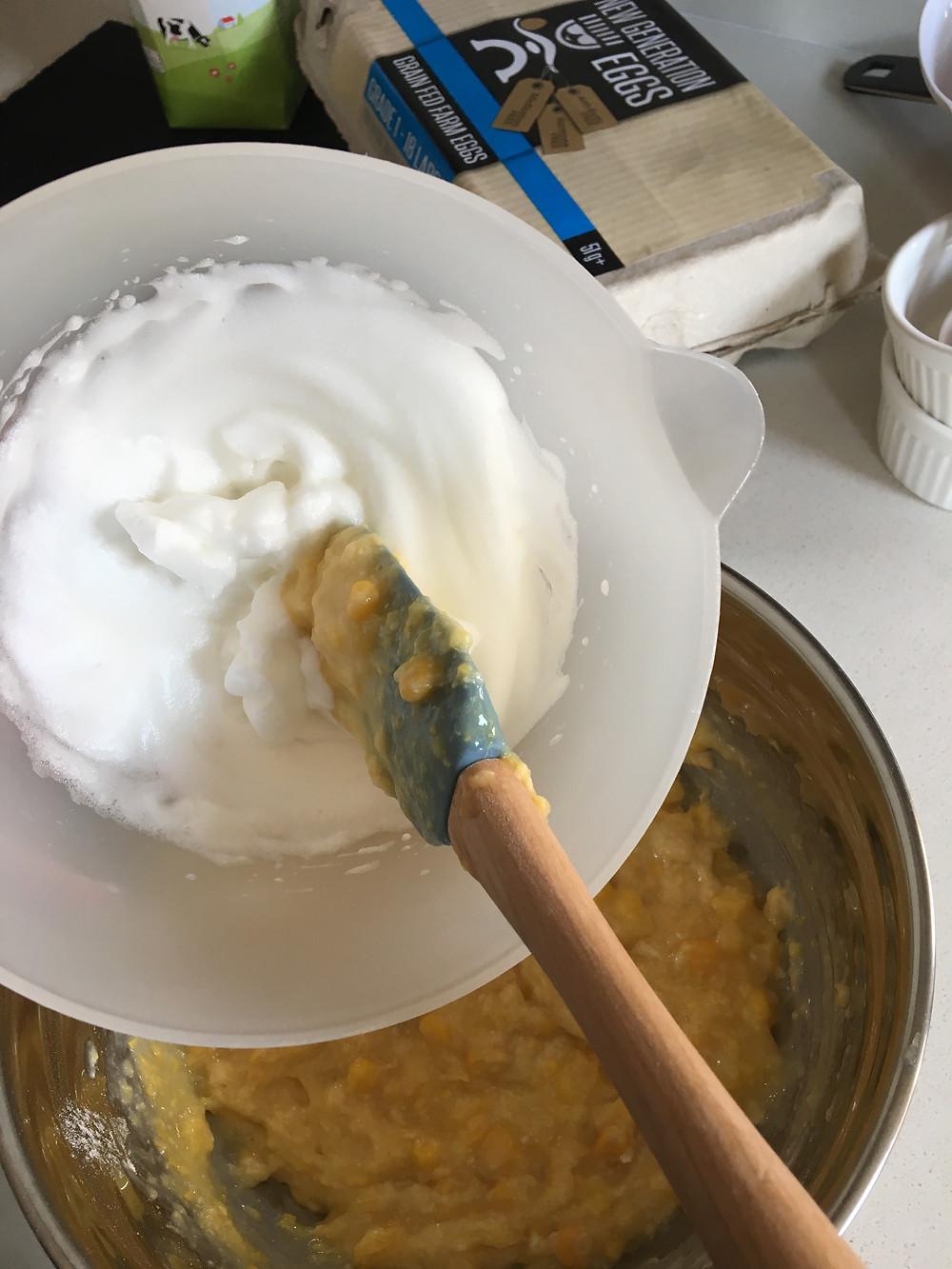 Folding the egg whites into the sweetcorn batter