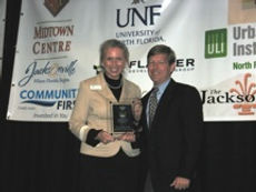 Lynn Thompson accepts award at JaxPride luncheon