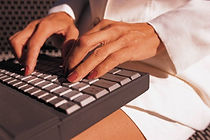 fingers on keyboard for online writing