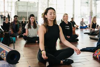 Photo of woman meditating at Brooklyn Expo.jpg