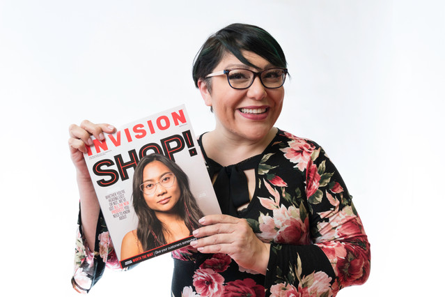 Photo of hapy customer holding a magazine.jpg