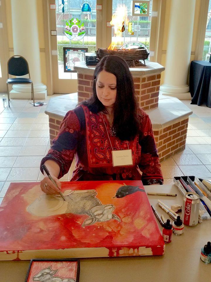 Artist Lynnette Shelley doing a demonstration at the Malvern Retreat House Art Show
