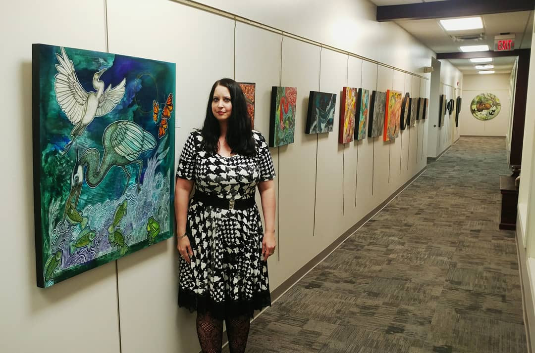 Artist Lynnette Shelley at her solo show at the gallery at Community Music School