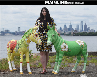 Artist Lynnette Shelley with her two DNC Donkeys