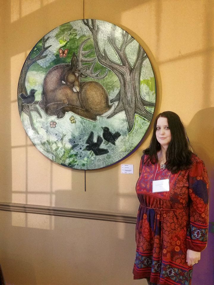 "Artist Lynnette Shelley with her artwork ""Sleeping Stag"" at the 2020 Malvern Retreat House Art Show"