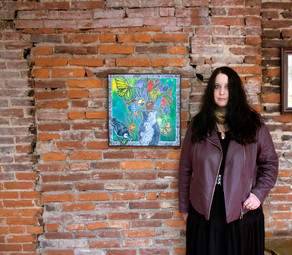 "Artist Lynnette Shelley with her artwork ""From the Garden"""