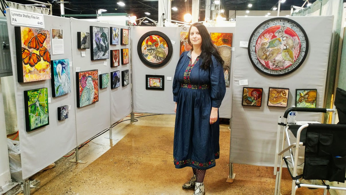 Artist Lynnette Shelley in front of her booth at Sugarloaf Craft Festival