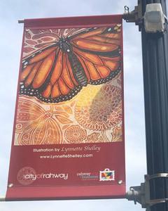 Lynnette's artwork on a banner on Cherry Street in Rahway, NJ