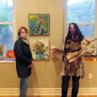 Artist Lynnette Shelley with one of her collectors at Exhibit B Gallery in Souderton, PA