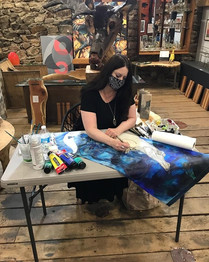 """Artist Lynnette Shelley working on """"Blue Moon Rising"""" at a demo at Ivystone Studio in Downingtown"""