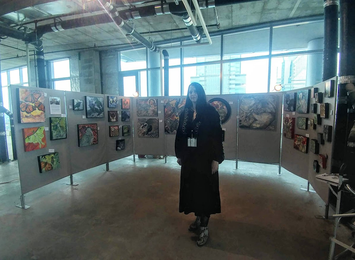Artist Lynnette Shelley at a pop up art show in Philadelphia.