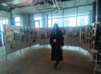 Artist Lynnette Shelley at a pop up art show in Philadelphia.