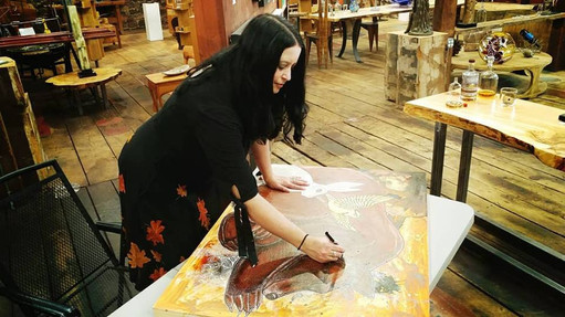 """Artist Lynnette Shelley working on """"Dreaming Bear"""" during an art demo at Ivystone Studio (Fall 2018)"""