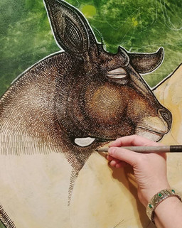 Artist Lynnette Shelley working on Sleeping Stag