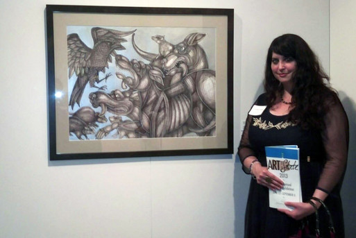 """Artist Lynnette Shelley with her work """"The Dogs of War""""at the 2013 Art of the State"""