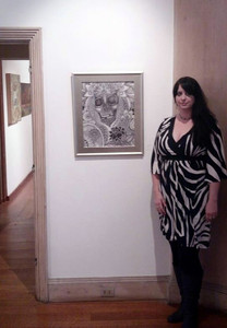 Artist Lynnette Shelley with her painting Relic at Abington Art Center in Jenkintown, PA