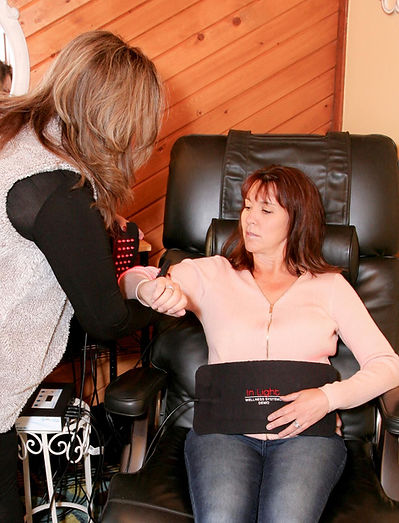 Light therapist Lisa Chadsey adding a light system to a client