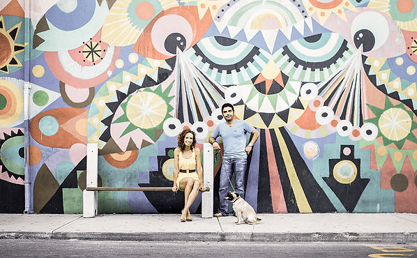 Dede Brown Photography - Fun Engagement Photo Session with Ellen, Omar and their pug, Chipotle, in front of large colorful mural in Downtown Nassau, Bahamas