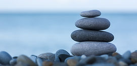 Stack of round smooth stones on a seasho