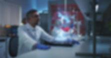 Medium shot of a male scientist examinin