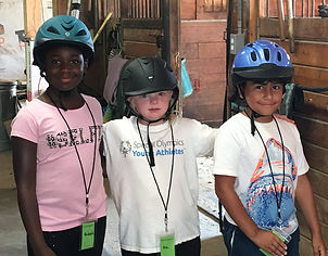 3 kids standing together in Horse SenseAbility's City to Saddle program