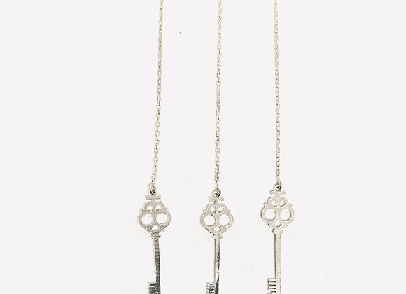 """The Key"" threaded earring"