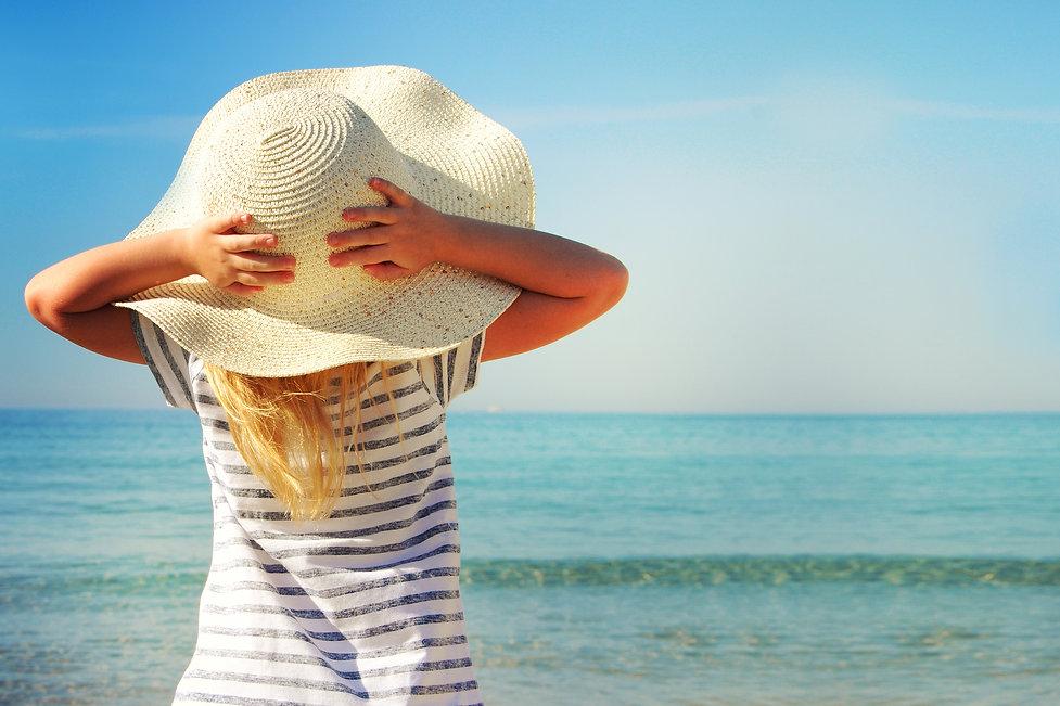 Happy little girl on beach vacation.jpg