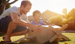 bigstock-son-and-dad-playing-with-toy-a-