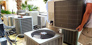 hvac-technician-removing-old-rusted-brok